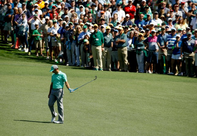 Sergio Garcia, of Spain, reacts after hitting a ball in the water on the 15th hole during the first round at the Masters golf tournament Thursday, April 5, 2018, in Augusta, Ga. Garcia shot an 8-over 13 on the hole. (AP Photo/Charlie Riedel)