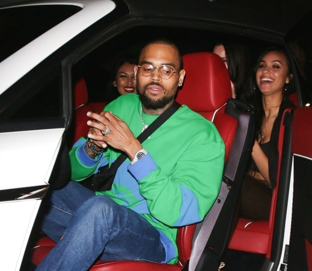 Hollywood, CA - Chris Brown ends a night out at TAO with a few female friends. The singer, who is currently under fire over a photo, hops in his ride after buying flowers for friends. He and the valet allegedly get into a little disagreement before he heads into his car. Pictured: Chris Brown BACKGRID USA 5 APRIL 2018 BYLINE MUST READ: Yolo / BACKGRID USA: +1 310 798 9111 / usasales@backgrid.com UK: +44 208 344 2007 / uksales@backgrid.com *UK Clients - Pictures Containing Children Please Pixelate Face Prior To Publication*