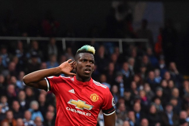 Manchester United's French midfielder Paul Pogba celebrates scoring his team's second goal during the English Premier League football match between Manchester City and Manchester United at the Etihad Stadium in Manchester, north west England, on April 7, 2018. / AFP PHOTO / Ben STANSALL / RESTRICTED TO EDITORIAL USE. No use with unauthorized audio, video, data, fixture lists, club/league logos or 'live' services. Online in-match use limited to 75 images, no video emulation. No use in betting, games or single club/league/player publications. / BEN STANSALL/AFP/Getty Images