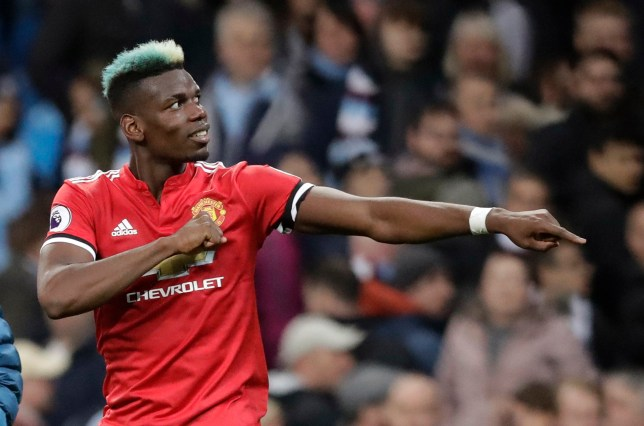 eb584b86c Manchester United s Paul Pogba celebrates at the end of the English Premier  League soccer match between