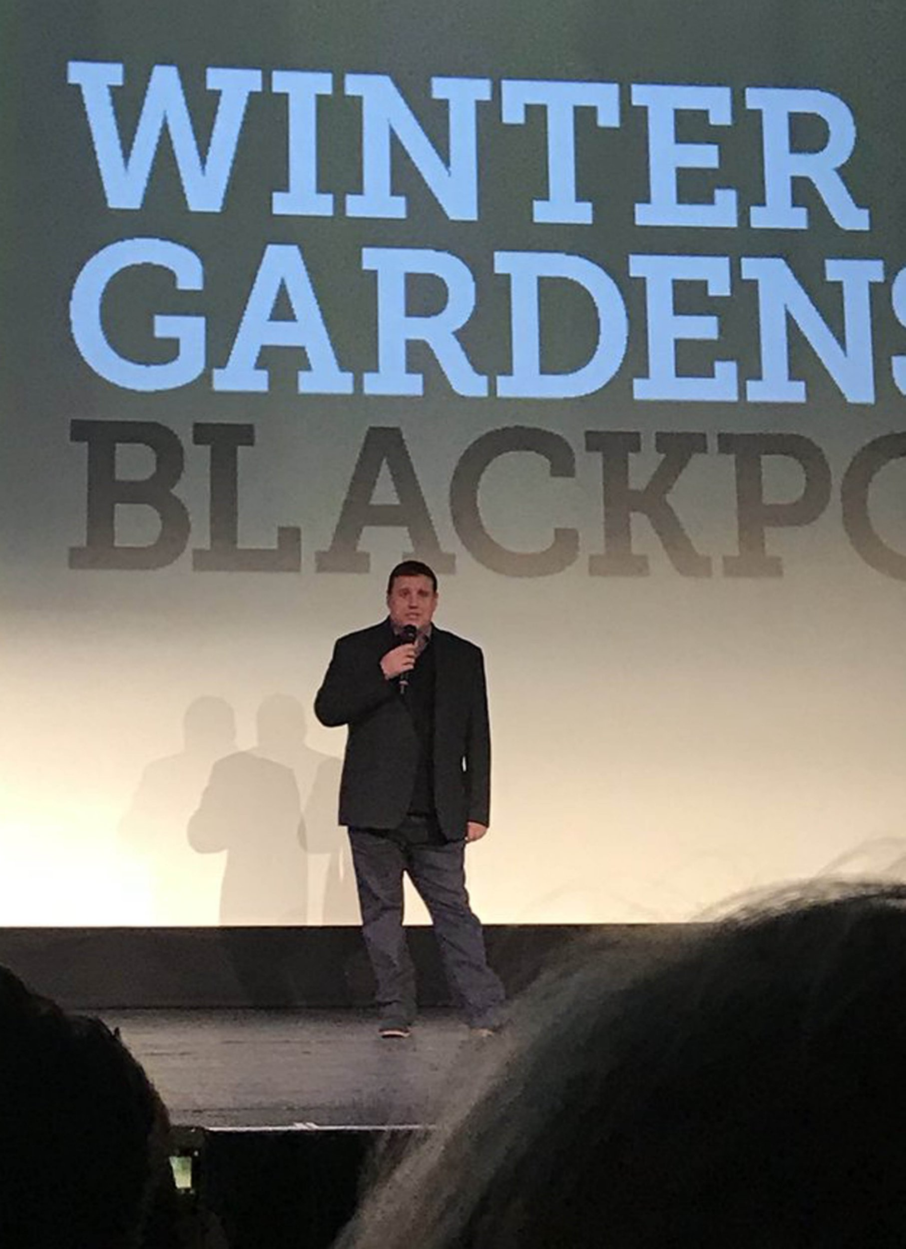 """BEST QUALITY AVAILABLE Picture taken with permission from the twitter feed of @hannahjharrison of comedian Peter Kay addressing the audience at a charity screening of his popular BBC comedy programme at the Blackpool Opera House. PRESS ASSOCIATION Photo. Issue date: Sunday April 8, 2018. The comedian, who cancelled his live tour due to """"unforeseen family circumstances"""" in December, took to the stage at Blackpool Winter Gardens on Saturday evening. See PA story SHOWBIZ Kay. Photo credit should read: @hannahjharrison/Twitter/PA Wire NOTE TO EDITORS: This handout photo may only be used in for editorial reporting purposes for the contemporaneous illustration of events, things or the people in the image or facts mentioned in the caption. Reuse of the picture may require further permission from the copyright holder."""