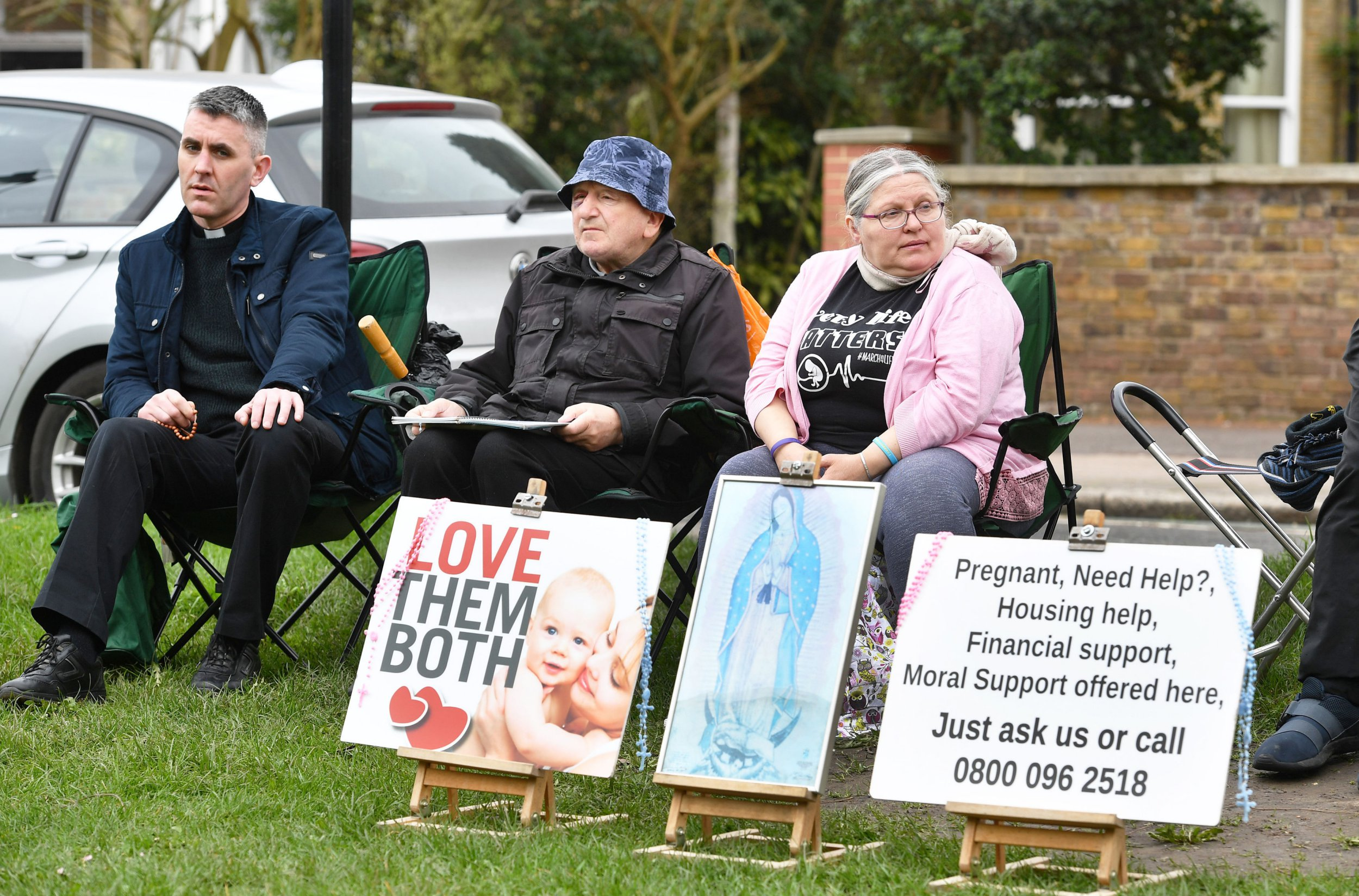"""EMBARGOED TO 0001 TUESDAY APRIL 10 Pro-life demonstrators outside the Marie Stopes clinic on Mattock Lane, ahead of a vote by Ealing Council on whether to implement a safe zone outside the west London abortion clinic to protect women from being intimidated. PRESS ASSOCIATION Photo. Picture date: Saturday April 7, 2018. The local authority has been exploring a range of options on how to prevent """"intimidation, harassment and distress"""" for women using the Marie Stopes clinic on Mattock Lane following a petition set up by local women. See PA story POLITICS Abortion. Photo credit should read: John Stillwell/PA Wire"""