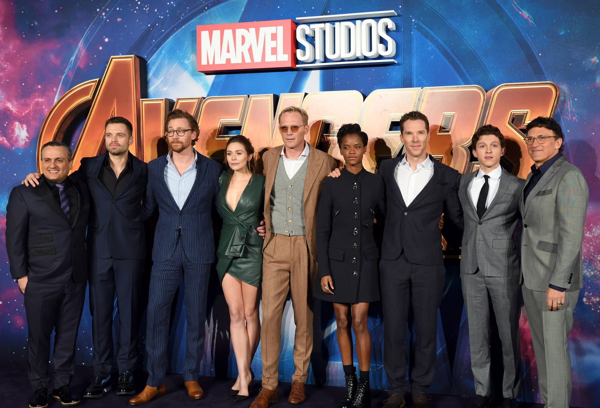 """LONDON, ENGLAND - APRIL 08: (L-R) Joe Russo, Sebastian Stan, Tom Hiddleston, Elizabeth Olsen, Paul Bettany, Letitia Wright, Benedict Cumberbatch, Tom Holland and Anthony Russo attend the UK Fan Event for """"Avengers Infinity War"""" at Television Studios White City on April 8, 2018 in London, England. (Photo by Karwai Tang/WireImage)"""