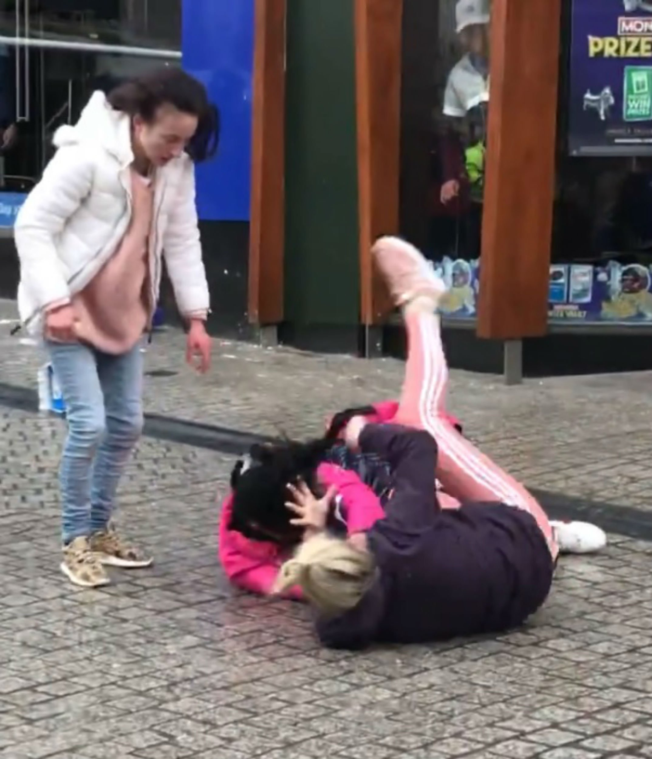 A SICKENING video shows two women in a savage street brawl ourtside a McDonald's - watched by a crowd of 100 shoppers. One of the women leaps at her victim, grabbing her hair and viciously pulling her to the ground before launching into a series of brutal kicks and punches to her head. The pair scrapped for several minutes before any of the onlookers intervened and police said they appeared to have received no reports about the incident. Just three months ago, another group of women were filmed fighting outside the same McDonald's in Waterford, Ireland. Robbie Coleman shared footage of the disturbing fight on Facebook with the caption: ?It is ridiculous what goes on around this country.? The video, which has now been viewed over 237,000 times, begins with three women arguing in the centre of Waterford.