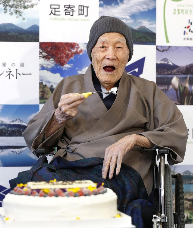 Japanese Masazo Nonaka, who was born 112 years and 259 days ago, eats his favorite cake as he receives a Guinness World Records certificate naming him the world's oldest man during a ceremony in Ashoro, on Japan's northern island of Hokkaido, in this photo taken by Kyodo April 10, 2018. Mandatory credit Kyodo/via REUTERS ATTENTION EDITORS -THIS IMAGE WAS PROVIDED BY A THIRD PARTY. EDITORIAL USE ONLY. MANDATORY CREDIT. JAPAN OUT. NO COMMERCIAL OR EDITORIAL SALES IN JAPAN.