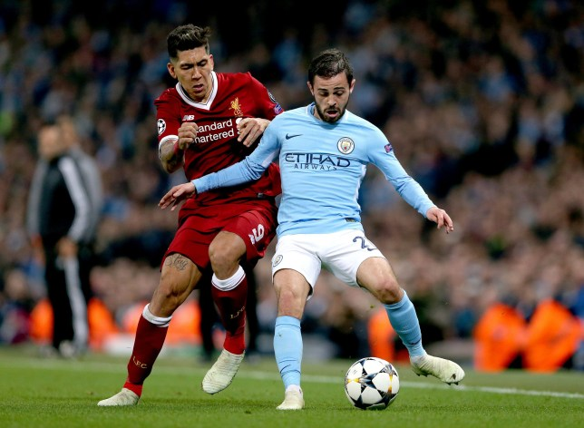 Liverpool's Roberto Firmino (left) and Manchester City's Bernardo Silva (right) battle for the ball during the UEFA Champions League, Quarter Final at the Etihad Stadium, Manchester. PRESS ASSOCIATION Photo. Picture date: Tuesday April 10, 2018. See PA story SOCCER Man City. Photo credit should read: Tim Goode/PA Wire