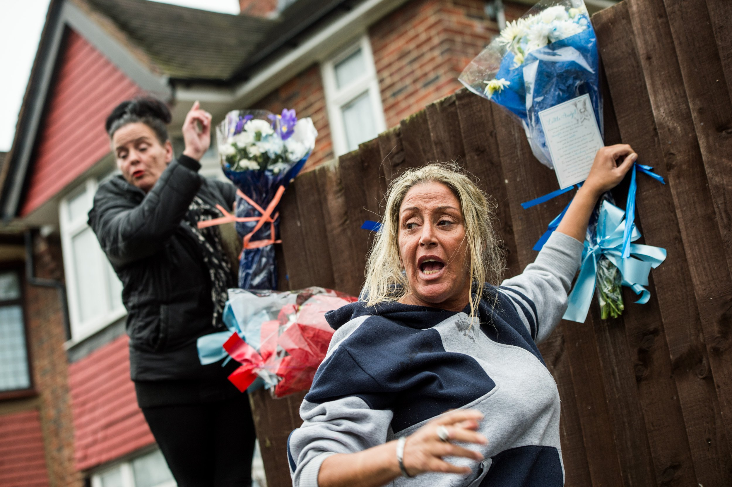 LONDON, UNITED KINGDOM - APRIL 10: Two women are pictured bringing flowers to the makeshift shrine to Vincent opposite Mr Osborn-Brooks' home on April 10, 2018 in London, England. Pensioner Richard Osborn-Brooks has been released without charge after he confronted a pair of burglars at his home in South East London, killing one of them. PHOTOGRAPH BY Brais G. Rouco / Barcroft Images