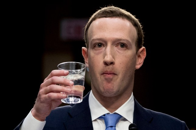 Facebook CEO Mark Zuckerberg, takes a drink of water while testifying before a joint hearing of the Commerce and Judiciary Committees on Capitol Hill in Washington, Tuesday, April 10, 2018, about the use of Facebook data to target American voters in the 2016 election. (AP Photo/Andrew Harnik)