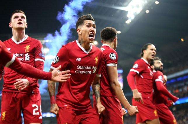 Roberto Firmino celebrates Mohamed Salah GOAL MANCHESTER CITY V LIVERPOOL FC ETIHAD STADIUM, MANCHESTER, ENGLAND 10/04/2018