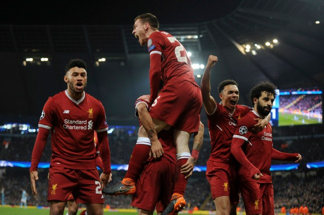 Liverpool's Mohamed Salah, right, celebrates scoring his side's first goal with his teammates in front of their fans during the Champions League quarterfinal second leg soccer match between Manchester City and Liverpool at Etihad stadium in Manchester, England, Tuesday, April 10, 2018. (AP Photo/Rui Vieira)