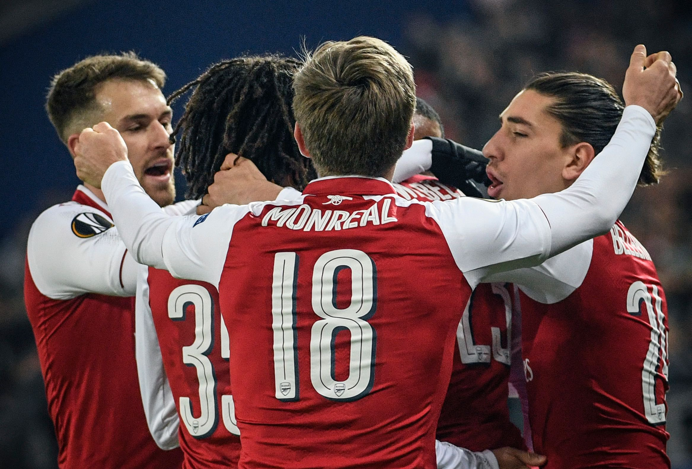 Arsenal's players celebrate a goal during the UEFA Europa League second leg quarter-final football match between CSKA Moscow and Arsenal at VEB Arena stadium in Moscow on April 12, 2018. / AFP PHOTO / Alexander NEMENOVALEXANDER NEMENOV/AFP/Getty Images