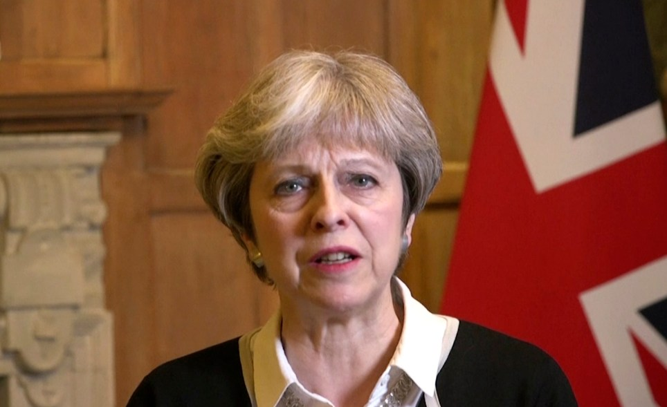 "In this image made from video provided by UK Government via AP Video, British Prime Minister Theresa May speaks in London, Saturday, April 14, 2018. In a message Prime Minister May announced early on Saturday morning that she has authorised British armed forces to ""conduct coordinated and targeted strikes to degrade the Syrian regime's chemical weapons capability and deter their use."" (UK Government via AP Video)"