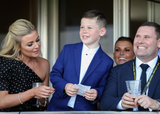 Mandatory Credit: Photo by Jed Leicester for The Jockey Club/REX/Shutterstock (9628951ak) Kai Rooney, son of Wayne and Coleen Rooney smiles as he watches the Gaskells Handicap Hurdle 2018 Randox Health Grand National Festival, Grand National Day, Horse Racing, Aintree Racecourse, Liverpool, UK - 14 Apr 2018