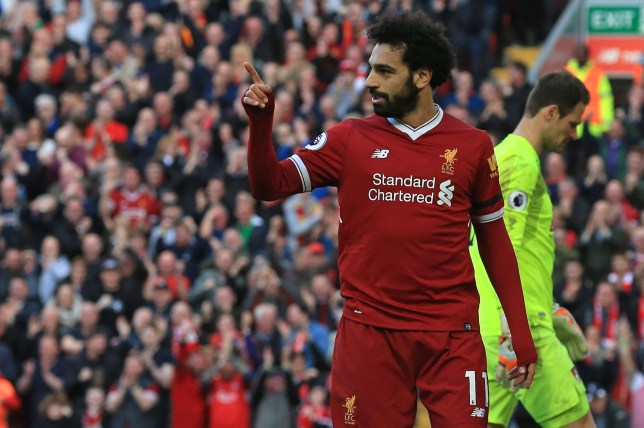 Liverpool's Egyptian midfielder Mohamed Salah celebrates after scoring their second goal during the English Premier League football match between Liverpool and Bournemouth at Anfield in Liverpool, north west England on April 14, 2018. / AFP PHOTO / Lindsey PARNABY / RESTRICTED TO EDITORIAL USE. No use with unauthorized audio, video, data, fixture lists, club/league logos or 'live' services. Online in-match use limited to 75 images, no video emulation. No use in betting, games or single club/league/player publications. / LINDSEY PARNABY/AFP/Getty Images
