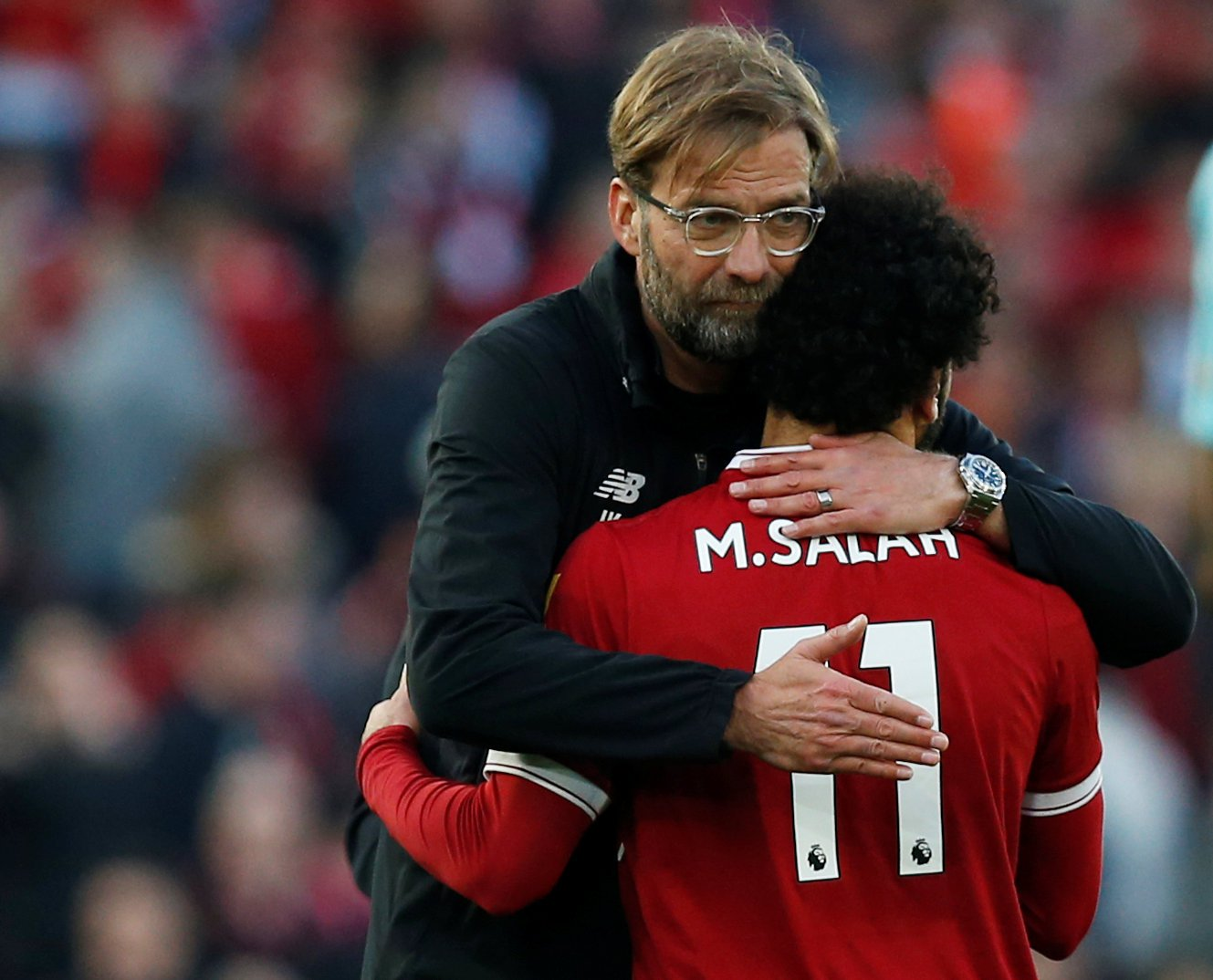 """Soccer Football - Premier League - Liverpool vs AFC Bournemouth - Anfield, Liverpool, Britain - April 14, 2018 Liverpool manager Juergen Klopp and Mohamed Salah celebrate after the match REUTERS/Andrew Yates EDITORIAL USE ONLY. No use with unauthorized audio, video, data, fixture lists, club/league logos or """"live"""" services. Online in-match use limited to 75 images, no video emulation. No use in betting, games or single club/league/player publications. Please contact your account representative for further details."""