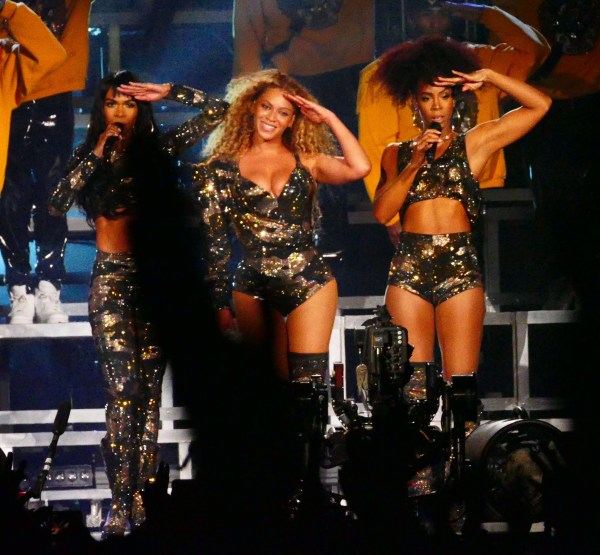 Destiny's Child reunite for Beyonce's first ever Coachella show as the fans went wild for them as they salute the 100k plus crowd in Cali. Beyonce showed off her wild hair and fashion and made faces while on stage as well as high in the sky on a cherry picker. Pictured: Destiny's Child, Beyonce Ref: SPL1682860 150418 Picture by: Aced1500 / Splash News Splash News and Pictures Los Angeles: 310-821-2666 New York: 212-619-2666 London: 870-934-2666 photodesk@splashnews.com
