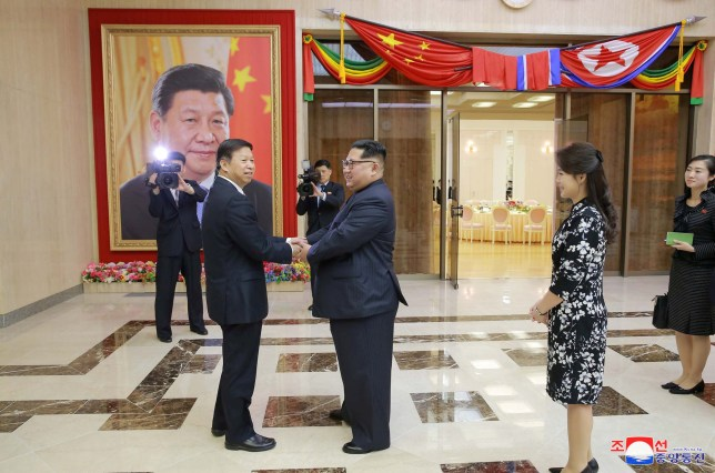 North Korean leader Kim Jong Un greets Song Tao, head of the Chinese Communist Party's international liaison department, in this undated photo released by North Korea's Korean Central News Agency (KCNA) in Pyongyang on April 18, 2018. KCNA/via Reuters ATTENTION EDITORS - THIS IMAGE WAS PROVIDED BY A THIRD PARTY. REUTERS IS UNABLE TO INDEPENDENTLY VERIFY THIS IMAGE. NO THIRD PARTY SALES. SOUTH KOREA OUT. NO COMMERCIAL OR EDITORIAL SALES IN SOUTH KOREA. TPX IMAGES OF THE DAY