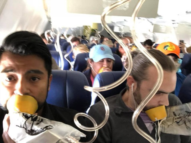 Southwest Airlines jet blew the engine at 32,000 feet and got hit by shrapnel that smashed a window, setting off a desperate scramble by passengers to save a woman from getting sucked out. Taken without permission from: https://www.facebook.com/marty.martinez.96/posts/10211397654319286