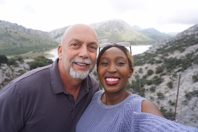 RAHAB KIMANI / CATERS NEWS - (PICTURED: Rahab and Joe on their vacation in Spain.) - A student branded disgusting by her friends for her 33-year age gap relationship is determined to prove her critics wrong as she celebrates her one-year anniversary.Rahab Kimani, 21, of Barnaget, New Jersey, USA, felt attracted to her boss Joe Singiser, 54, when he was helping her move last year.After telling her friends who called her disgusting and nasty, the nursing home supervisor asked for her phone number, which led her to change her mind about her move to Boston - SEE CATERS COPY