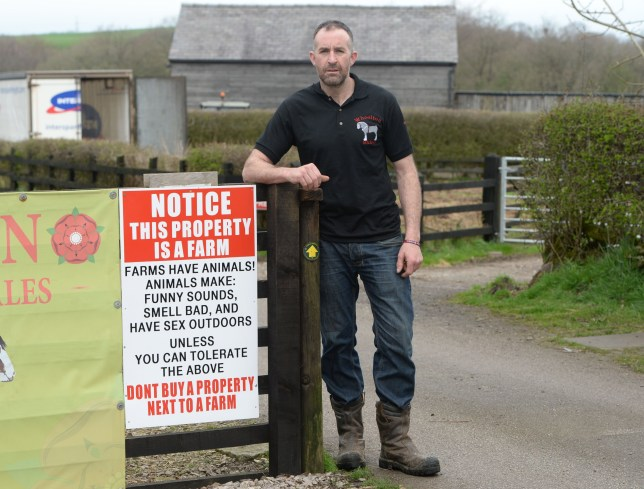 Stephen Nolan from Wheelton, Lancs., has installed a quirky sign at the front of his farm after complaints from rural moaners. See ROSS PARRY story RPYHORSE : A farmer fed up with people complaining about the noise and smells of the countryside has posted a quirky sign to combat the moaners. The notice at Laneside Farm in Higher Wheelton, Lancs., was put up after the farmer received a complaint about noise from his animals. 18 April 2018.