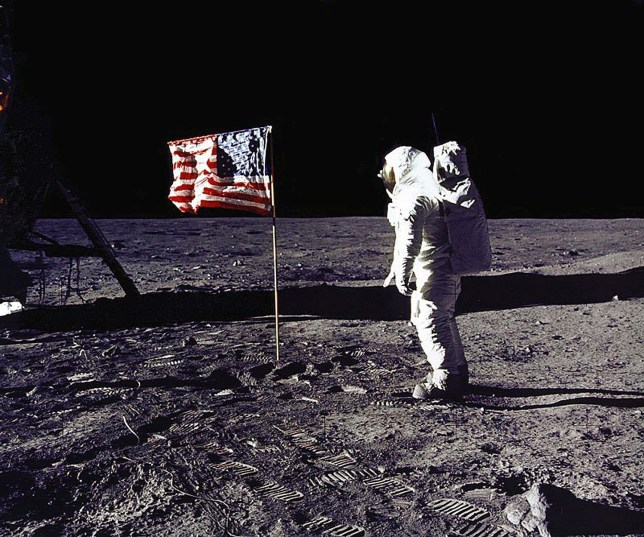 """DC, UNITED STATES: This 20 July 1969 file photo released by NASA shows astronaut Edwin E. """"Buzz"""" Aldrin, Jr. saluting the US flag on the surface of the Moon during the Apollo 11 lunar mission. The 20th July 1999 marks the 30th anniversary of the Apollo 11 mission and man's first walk on the Moon. AFP PHOTO NASA (Photo credit should read NASA/AFP/Getty Images)"""