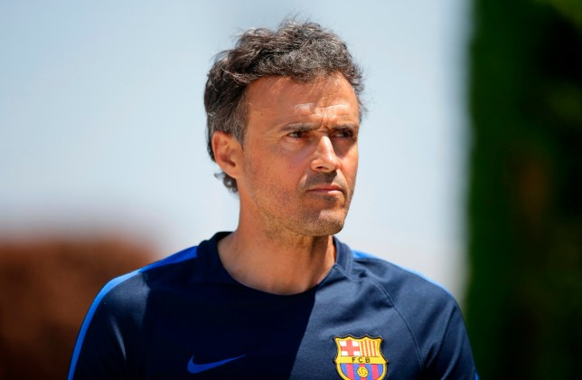 FILE - In this Friday, May 26, 2017 file photo, FC Barcelona's coach Luis Enrique attends a press conference at the Sports Center FC Barcelona Joan Gamper in Sant Joan Despi, Spain. Arsenal is looking for a new manager for the first time this century after Arsene Wenger on Friday, April 20, 2018 announced his decision to leave his role at the end of this season. Arsenal has reportedly made informal contact with Luis Enrique, the former Barcelona coach who led the Spanish team to the La Liga-Copa del Rey-Champions League treble in his first season there in 2015 and a domestic league-and-cup double the following year. (AP Photo/Manu Fernandez, file)