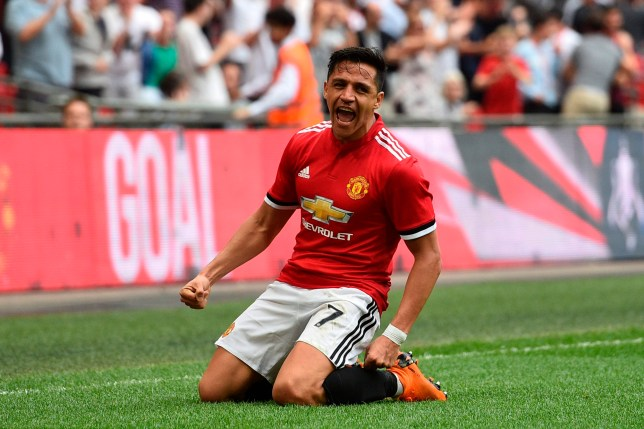 Manchester United's Chilean striker Alexis Sanchez celebrates after scoring their first goal to equalise 1-1 during the English FA Cup semi-final football match between Tottenham Hotspur and Manchester United at Wembley Stadium in London, on April 21, 2018. / AFP PHOTO / Glyn KIRK / NOT FOR MARKETING OR ADVERTISING USE / RESTRICTED TO EDITORIAL USE GLYN KIRK/AFP/Getty Images