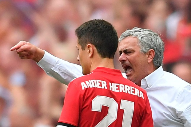 Manchester United's Portuguese manager Jose Mourinho (R) has words with Manchester United's Spanish midfielder Ander Herrera (L) on the touchline during the English FA Cup semi-final football match between Tottenham Hotspur and Manchester United at Wembley Stadium in London, on April 21, 2018. / AFP PHOTO / Ben STANSALL / NOT FOR MARKETING OR ADVERTISING USE / RESTRICTED TO EDITORIAL USE BEN STANSALL/AFP/Getty Images