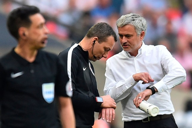 Manchester United's Portuguese manager Jose Mourinho (R) talks to fourth official Kevin Friend during the English FA Cup semi-final football match between Tottenham Hotspur and Manchester United at Wembley Stadium in London, on April 21, 2018. / AFP PHOTO / Glyn KIRK / NOT FOR MARKETING OR ADVERTISING USE / RESTRICTED TO EDITORIAL USE GLYN KIRK/AFP/Getty Images