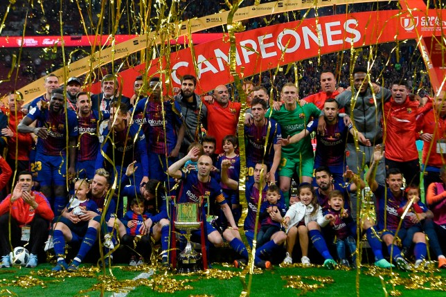 Barcelona's players pose with the trophy after winning the Spanish Copa del Rey (King's Cup) final football match Sevilla FC against FC Barcelona at the Wanda Metropolitano stadium in Madrid on April 21, 2018. Barcelona won 5-0. / AFP PHOTO / LLUIS GENELLUIS GENE/AFP/Getty Images