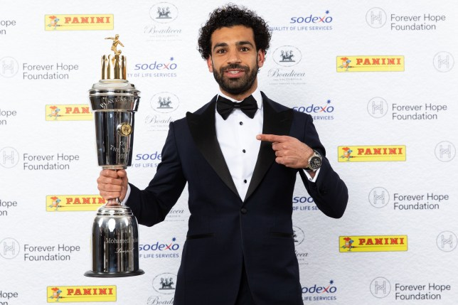 EMBARGOED FOR ALL USAGES UNTIL 00.01 ON MONDAY APRIL 23, 2018, OR UNTIL AN OFFICIAL WINNERS ANNOUNCEMENT IS MADE VIA THE @PFA TWITTER ACCOUNT. Liverpool's Mohamed Salah poses with the PFA Player Of The Year Award Trophy during the 2018 PFA Awards at the Grosvenor House Hotel, London. PRESS ASSOCIATION Photo. Picture date: Sunday April 22, 2018. See PA SOCCER PFA. Photo credit should read: Barrington Coombs/PA Wire