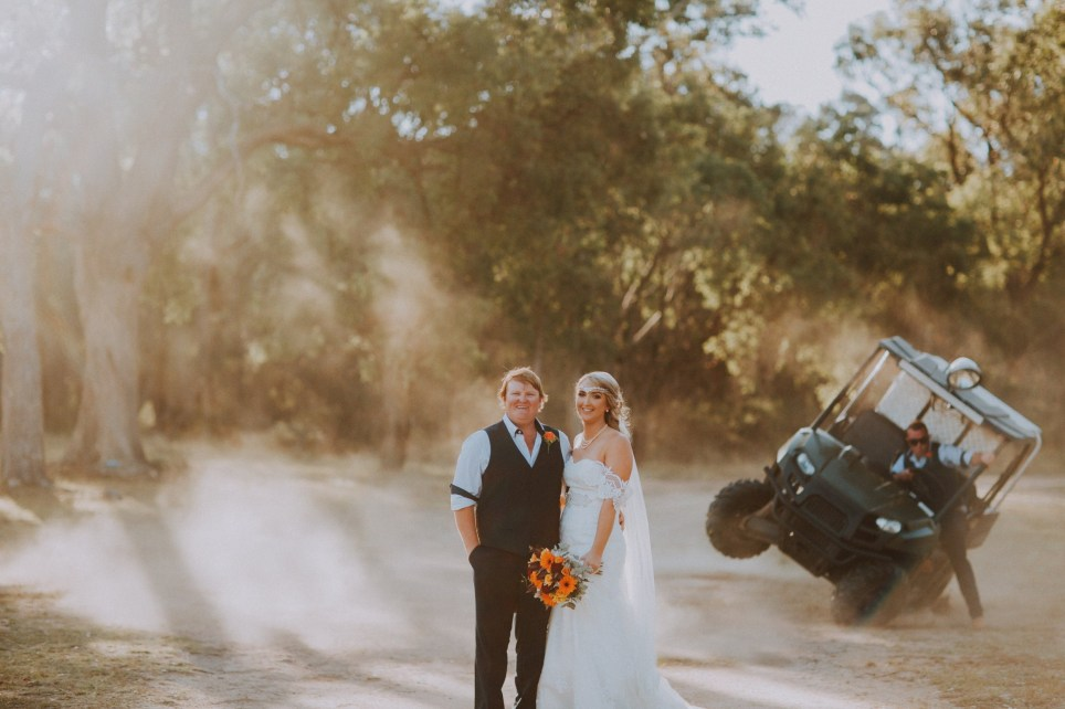 PIC FROM kennedynewsandmedia.co.uk / RNC Photography (PICTURED: MAT FARMER BEGINS TO TOPPLE OVER DURING MADELINE AND JOSH'S SHOOT) A groomsman ensured his role in the wedding won't be forgotten any time soon - when he accidentally rolled over in a golf buggy right behind the newlyweds in the wedding photos. Madeline and Josh Tattersall had asked Mat Farmer to use the golf cart to whip up some dust in the background to add atmosphere to their special wedding pictures. However the 31-year-old joker got carried away and went too fast, sending the caddy toppling over, almost crushing himself. SEE KENNEDY NEWS COPY