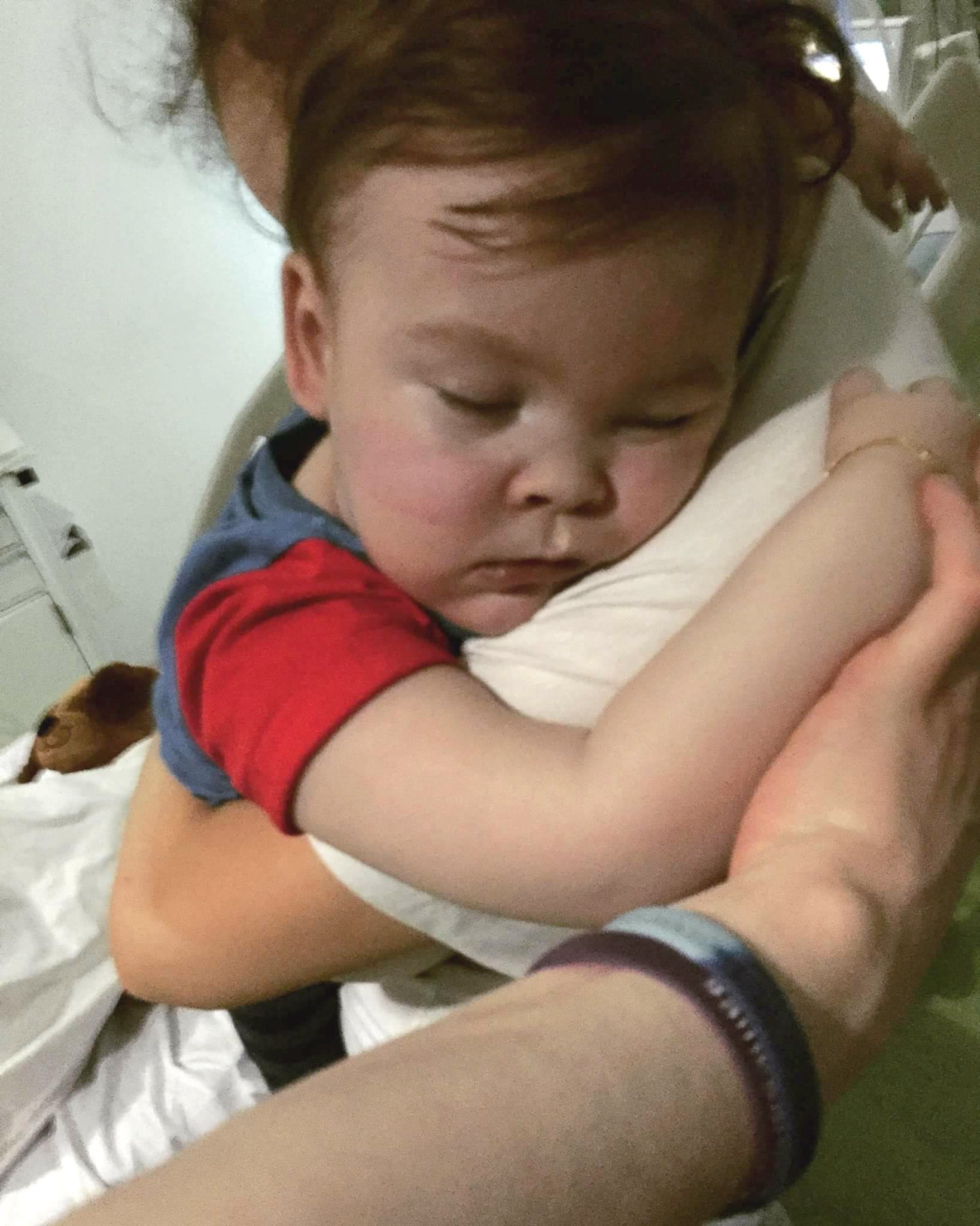 """Family handout photo dated 23/04/18 supplied by the Alfies Army Official facebook page of brain-damaged boy Alfie Evans cuddling his mother Kate James at Alder Hey Hospital, Liverpool. PRESS ASSOCIATION Photo. Issue date: Tuesday April 24, 2018. Doctors have been left """"gobsmacked"""" after Alfie's life-support was withdrawn but he continued to live, his father Tom Evans has said. See PA story COURTS Alfie. Photo credit should read: Alfies Army Official/PA Wire NOTE TO EDITORS: This handout photo may only be used in for editorial reporting purposes for the contemporaneous illustration of events, things or the people in the image or facts mentioned in the caption. Reuse of the picture may require further permission from the copyright holder."""