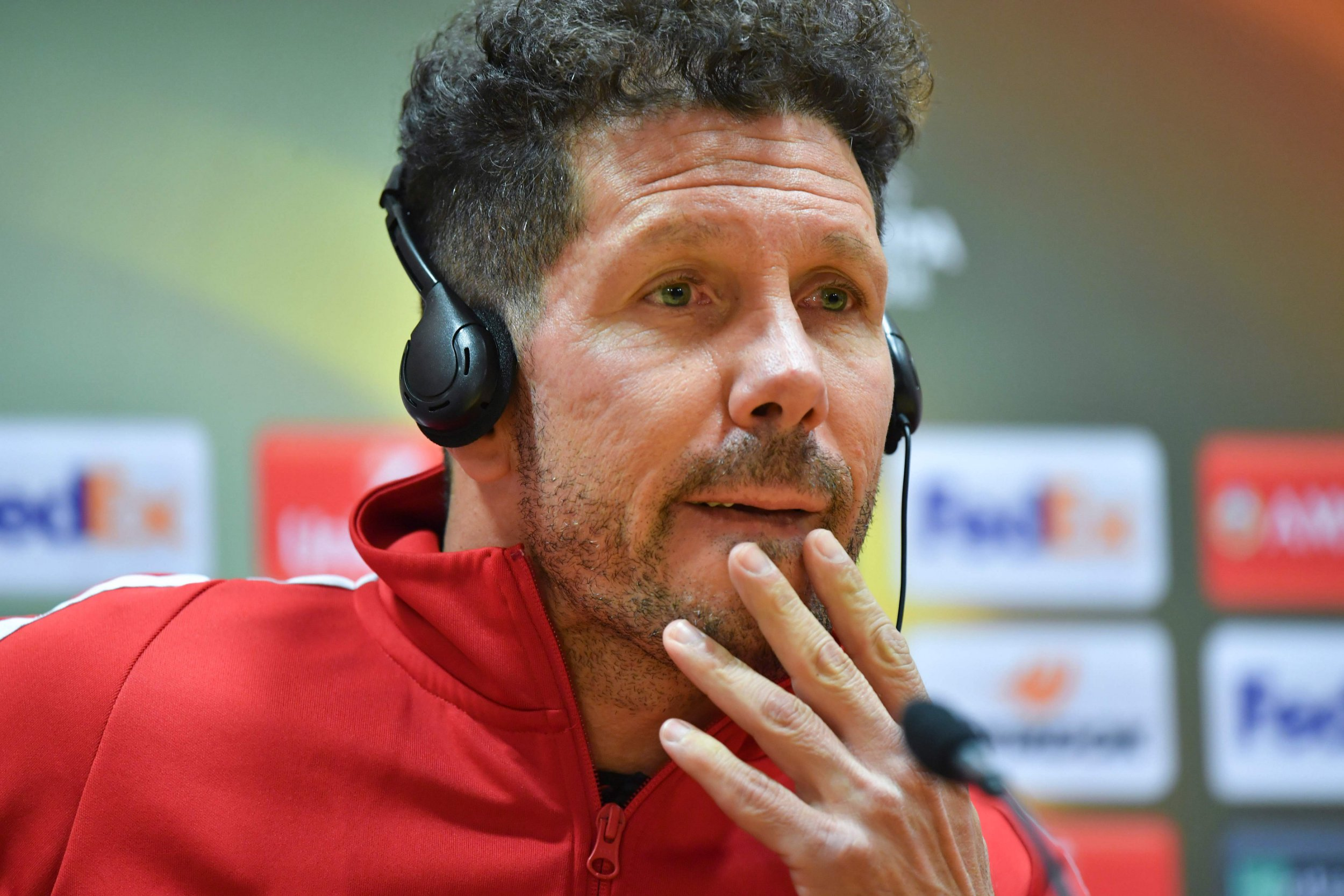 Atletico Madrid's Argentinian coach Diego Simeone listens during a press conference at the Emirates Stadium in London on April 25, 2018 on the eve of their UEFA Europa League first leg semi-final football match against Arsenal. / AFP PHOTO / Ben STANSALLBEN STANSALL/AFP/Getty Images