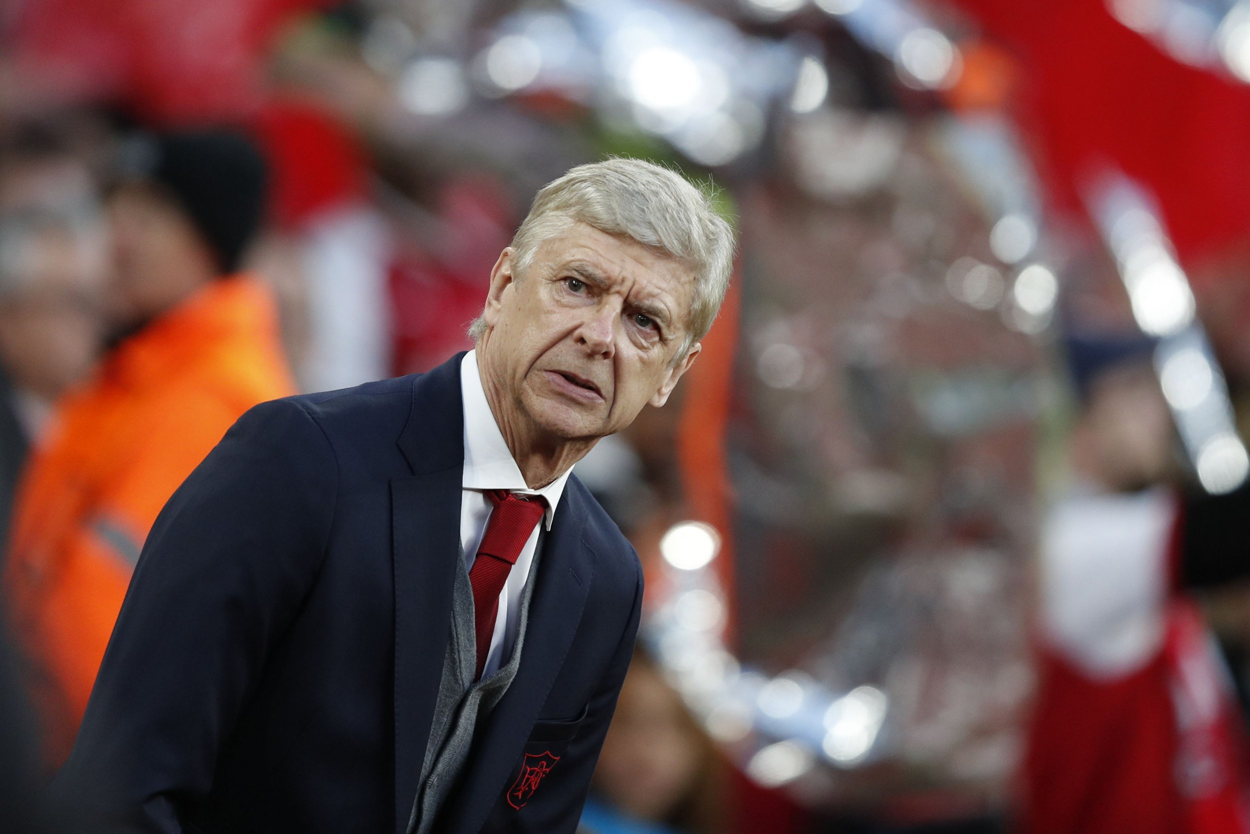 TOPSHOT - Arsenal's French manager Arsene Wenger awaits kick off in the UEFA Europa League first leg semi-final football match between Arsenal and Atletico Madrid at the Emirates Stadium in London on April 26, 2018. / AFP PHOTO / Adrian DENNISADRIAN DENNIS/AFP/Getty Images