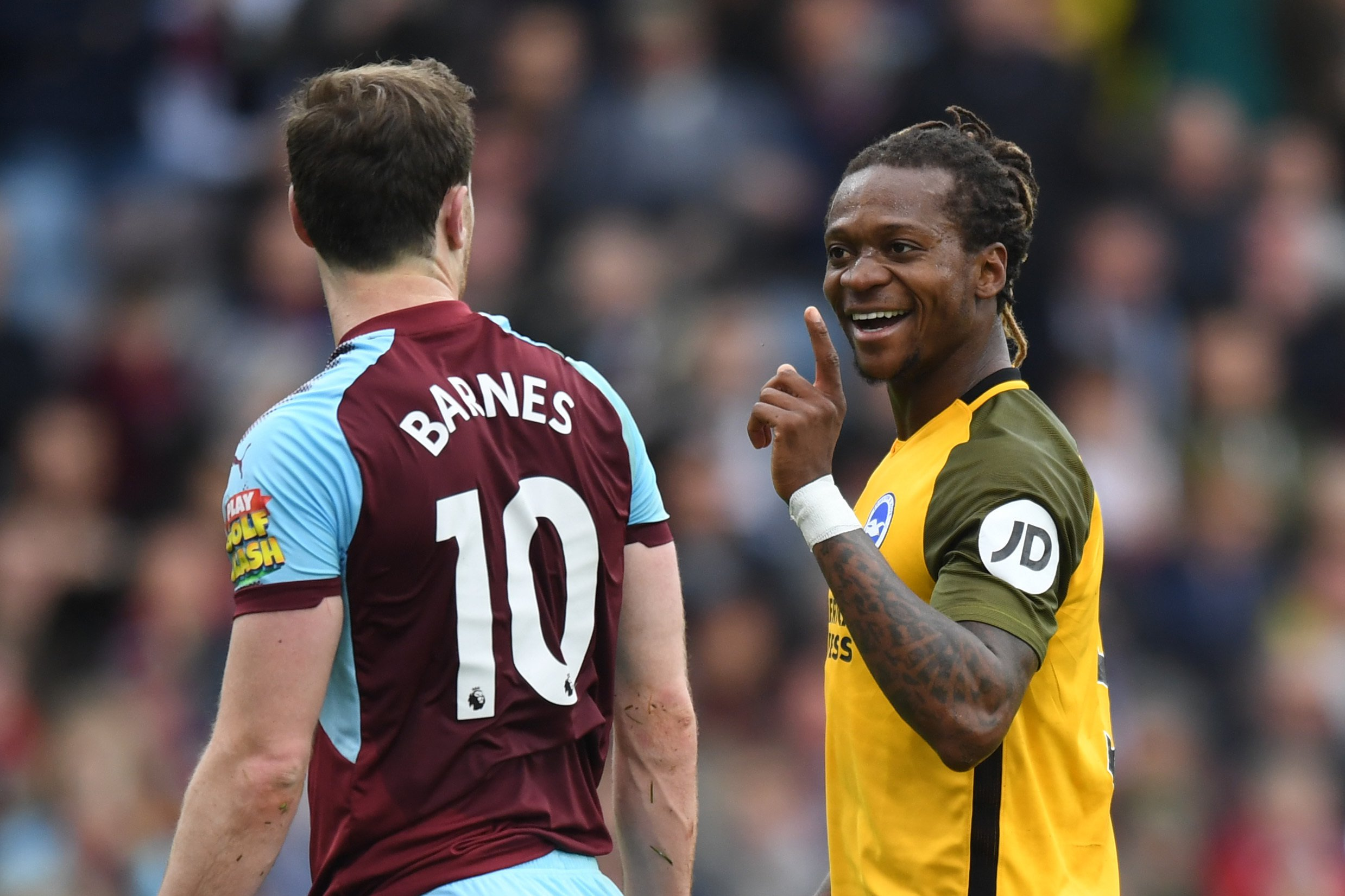 """Brighton and Hove Albion's Gaetan Bong gestures towards Burnley's Ashley Barnes during the Premier League match at Turf Moor, Burnley. PRESS ASSOCIATION Photo. Picture date: Saturday April 28, 2018. See PA story SOCCER Burnley. Photo credit should read: Anthony Devlin/PA Wire. RESTRICTIONS: EDITORIAL USE ONLY No use with unauthorised audio, video, data, fixture lists, club/league logos or """"live"""" services. Online in-match use limited to 75 images, no video emulation. No use in betting, games or single club/league/player publications."""
