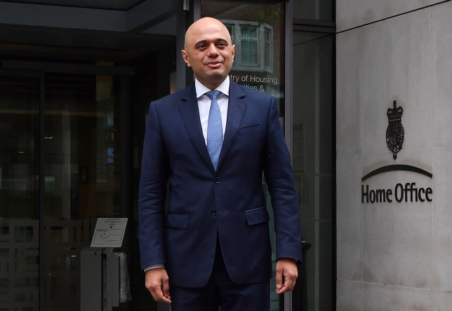 """Britain's newly appointed Home Secretary Sajid Javid poses for a photograph after exiting the Home Office in central London on April 30, 2018. Sajid Javid was named Monday as Britain's new interior minister after Amber Rudd resigned as home secretary, having """"inadvertently misled"""" lawmakers about deportation targets for illegal immigrants. Prime Minister Theresa May's Downing Street office announced the appointment in a statement. Javid was previously Britain's communities minister. / AFP PHOTO / Ben STANSALLBEN STANSALL/AFP/Getty Images"""