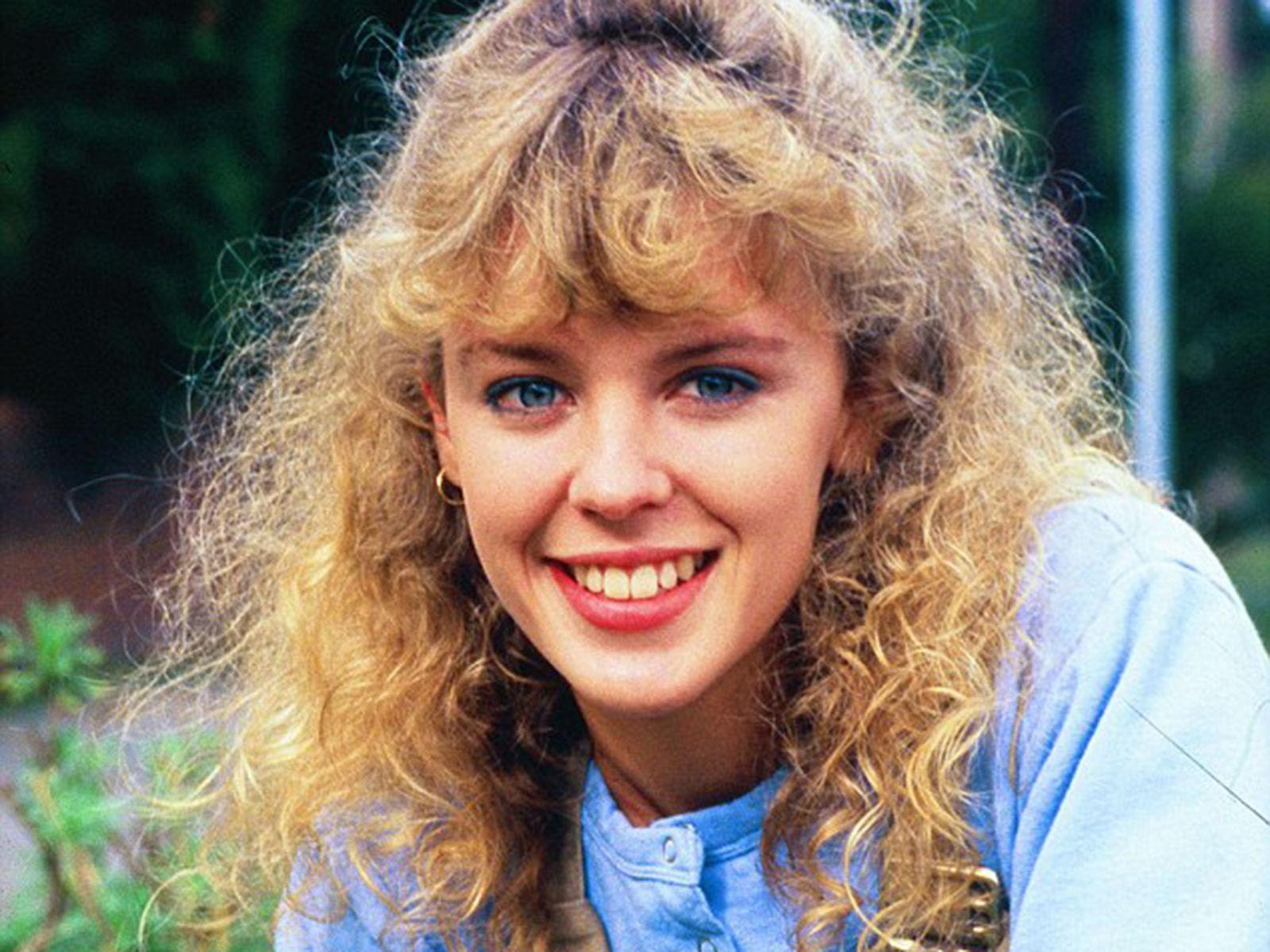 What is Kylie Minogue's net worth and what are her biggest selling songs as she turns 50