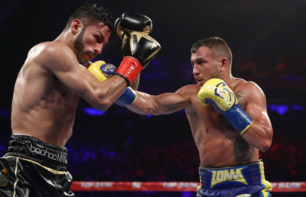 Vasyl Lomachenko stops Jorge Linares in a classic fight to become three-weight world champion
