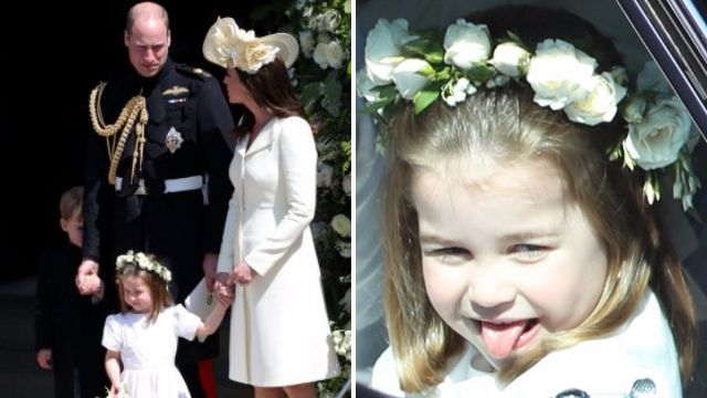 Princess Charlotte steals the show while shy George hides behind his father