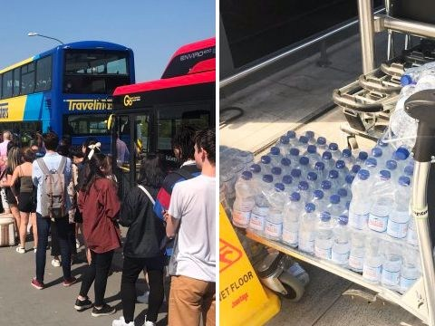 Travel chaos at Gatwick Airport as passengers queue two hours for a bus in the heat