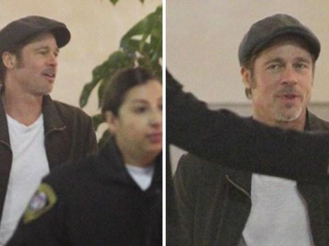 Brad Pitt is everyone's dad as he looks beside himself heading into U2 gig