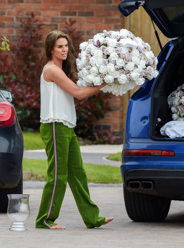 BGUK_1223459 - *EXCLUSIVE* Birmingham, UNITED KINGDOM - Model and former Miss GB Danielle Lloyd takes some very large flower arrangements out of the boot of her car with fiance Michael O Neill, sparking rumours of their wedding taking place over the weekend! The arrangements certainly looked fit for a bride! Pictured: Danielle Lloyd - Michael O Neill BACKGRID UK 4 MAY 2018 BYLINE MUST READ: James Watkins / BACKGRID UK: +44 208 344 2007 / uksales@backgrid.com USA: +1 310 798 9111 / usasales@backgrid.com *UK Clients - Pictures Containing Children Please Pixelate Face Prior To Publication*