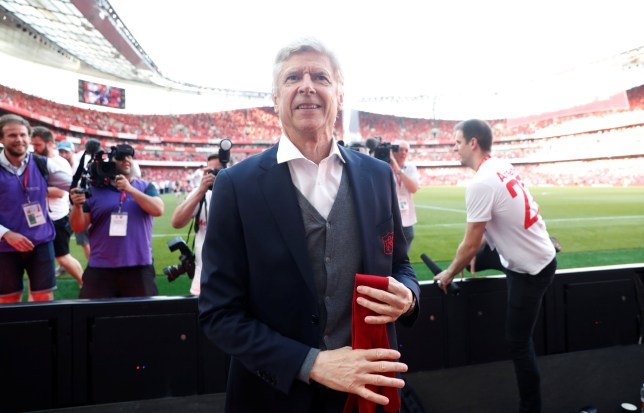 "Soccer Football - Premier League - Arsenal vs Burnley - Emirates Stadium, London, Britain - May 6, 2018 Arsenal manager Arsene Wenger takes his tie off to hand to a young fan during the lap of honour after the match Action Images via Reuters/Matthew Childs EDITORIAL USE ONLY. No use with unauthorized audio, video, data, fixture lists, club/league logos or ""live"" services. Online in-match use limited to 75 images, no video emulation. No use in betting, games or single club/league/player publications. Please contact your account representative for further details."