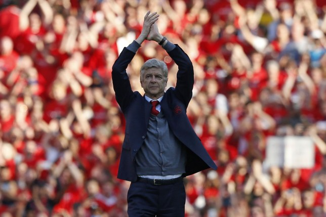 TOPSHOT - Arsenal's French manager Arsene Wenger gestures to supporters on the pitch after the English Premier League football match between Arsenal and Burnley at the Emirates Stadium in London on May 6, 2018. Arsene Wenger bids farewell to a stadium he helped to build in more ways than one when he leads Arsenal at the Emirates for the final time at home to Burnley on Sunday. Wenger's final season after 22 years in charge is destined to end in disappointment after Thursday's Europa League semi-final exit. / AFP PHOTO / IKIMAGES / Ian KINGTON / RESTRICTED TO EDITORIAL USE. No use with unauthorized audio, video, data, fixture lists, club/league logos or 'live' services. Online in-match use limited to 45 images, no video emulation. No use in betting, games or single club/league/player publications. / IAN KINGTON/AFP/Getty Images