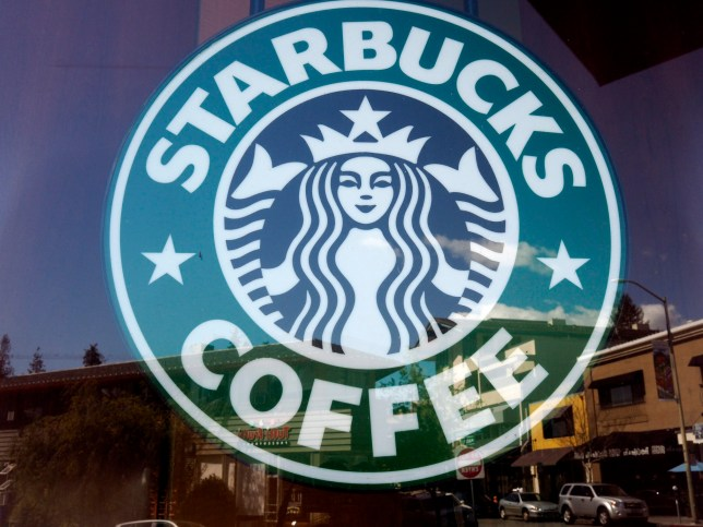 epa06716216 (FILE) - Starbucks signage in front of the store's window in Oakland, California, USA, 19 April 2018 (reissued 07 May 2018). Swiss-based food giant Nestle will pay 7.15 billion US dollars (about 5.99 billion Euros) to Starbucks for a global market license of the US coffee shop chain's products, Nestle announced on 07 May 2018. EPA/JOHN G. MABANGLO