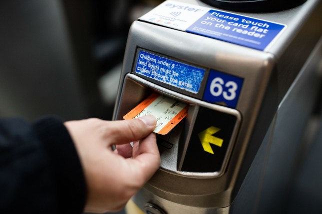 A commuter puts his paper ticket through the reader on the ticket barrier at London Marylebone railway station, operated by The Chiltern Railway Company Ltd., in London, U.K., on Wednesday, Dec. 2, 2015. Britain's railways have seen a jump in passenger numbers since privatization in the 1990s, with the nation ranked second in the European Union by total journeys behind Germany, which has about 2.6 billion a year, the Office of Rail and Road said. Photographer: Simon Dawson/Bloomberg via Getty Images