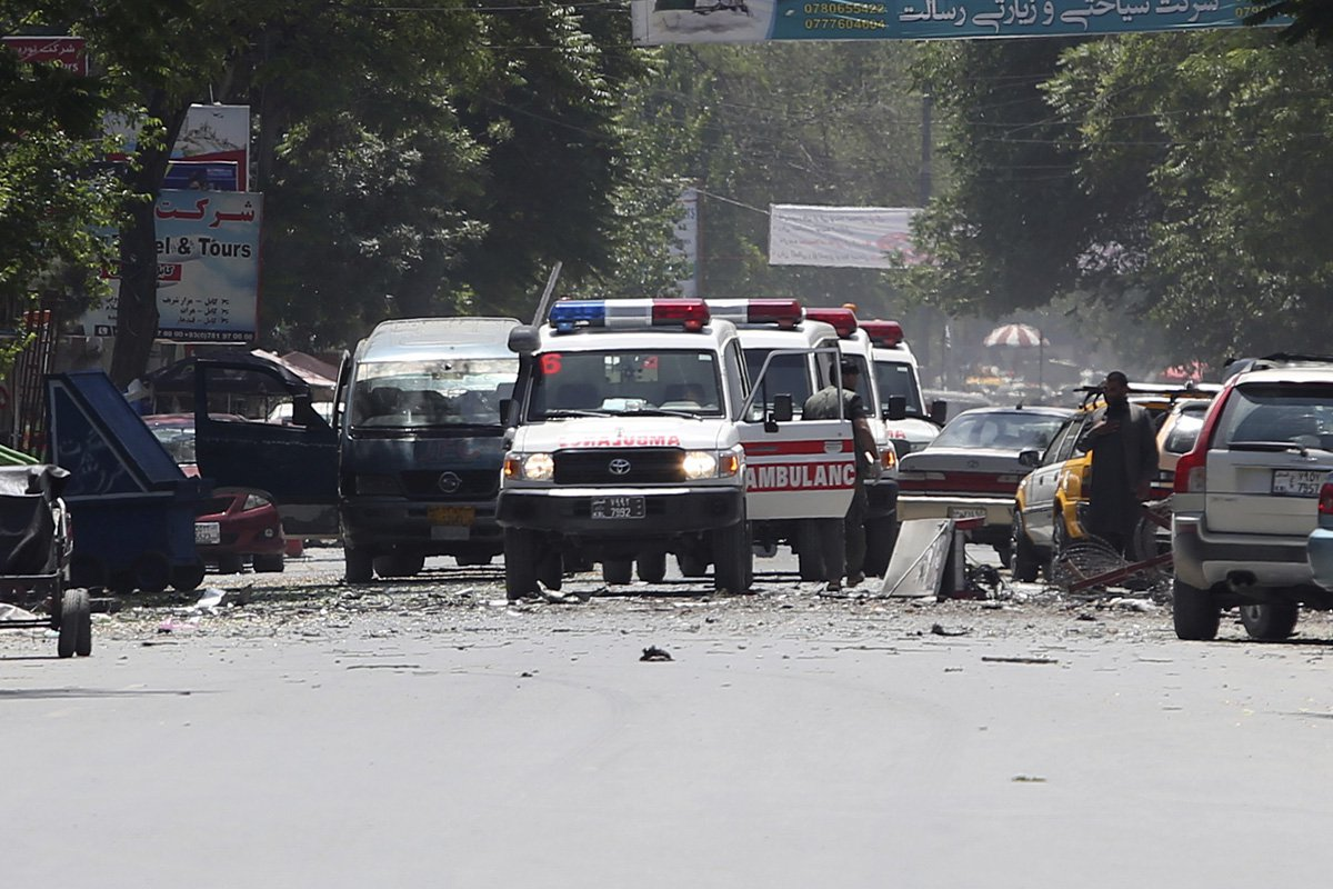 Series of explosions hit Afghanistan as suicide bombers target police stations