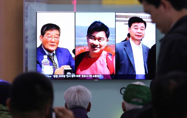 "FILE - In this May 3, 2018 photo, people watch a TV news report on screen, showing portraits of three Americans, Kim Dong Chul, left, Tony Kim and Kim Hak Song, right, detained in the North Korea, at the Seoul Railway Station in Seoul, South Korea. President Donald Trump says Secretary of State Mike Pompeo is on his way back from North Korea with three American detainees, saying they ""seem to be in good health."" (AP Photo/Ahn Young-joon)"