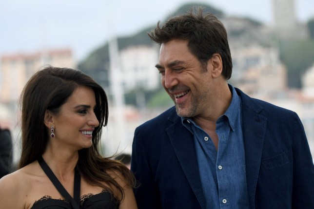 """TOPSHOT - Spanish actress Penelope Cruz (L) and her husband Spanish actor Javier Bardem pose on May 9, 2018 during a photocall for the film """"Todos Lo Saben (Everybody Knows)"""" at the 71st edition of the Cannes Film Festival in Cannes, southern France. / AFP PHOTO / Anne-Christine POUJOULATANNE-CHRISTINE POUJOULAT/AFP/Getty Images"""